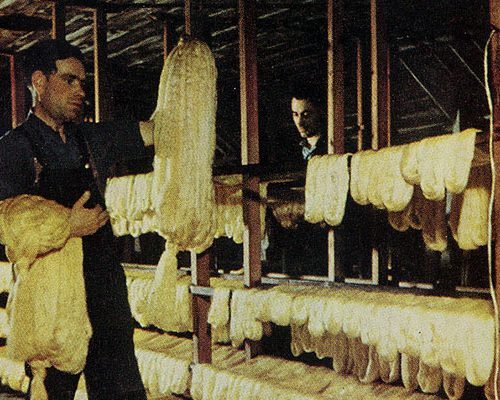 A silk mill worker preparing skeins of silk